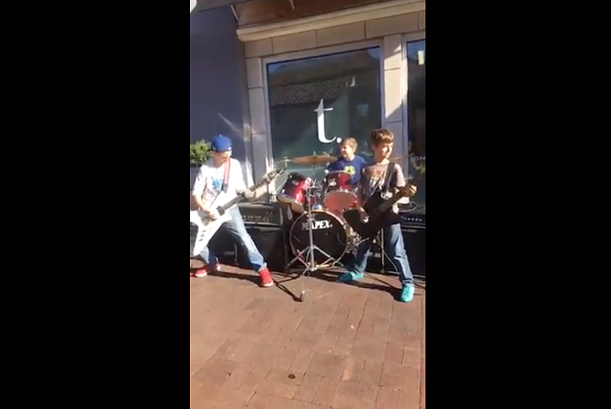 Three kids play Metallica songs outside mall, absolutely shred