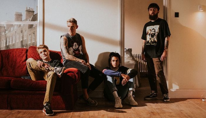 Neck Deep members collab with tattoo artist on merch line