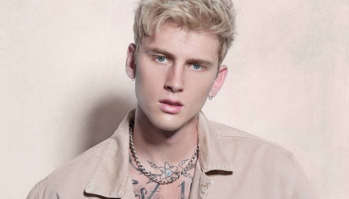 Machine Gun Kelly Climbs The Dirt Billboard For The Ultimate Photo Op