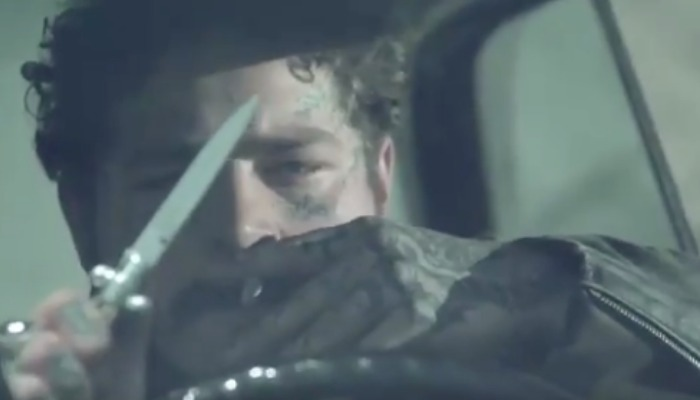 "Post Malone drives while holding a knife in new ""Goodbyes"