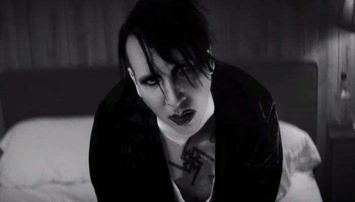 "Marilyn Manson buries the past in haunting ""God's Gonna Cut You Down"" cover"