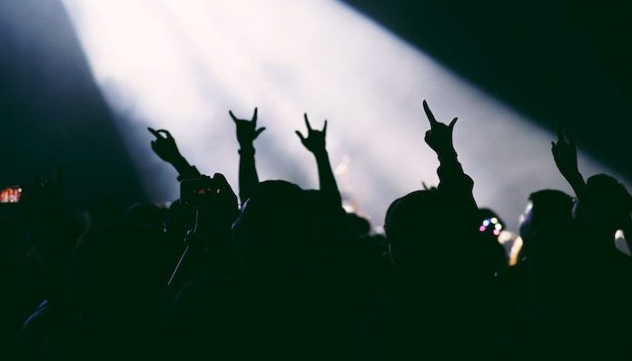 rock on hands concert crowd death metal band logos