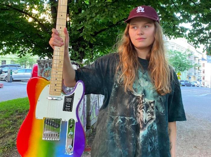 girl in red fender guitar-min